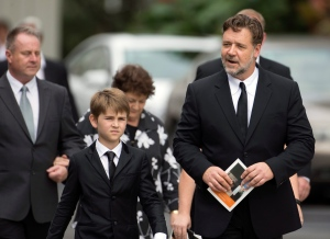 Hollywood actor Russell Crowe, right, arrives for the funeral of Martin Crowe at Holy Trinity Cathedral in Auckland, New Zealand, Friday, March 11, 2016. (Greg Bowker/New Zealand Herald via AP)