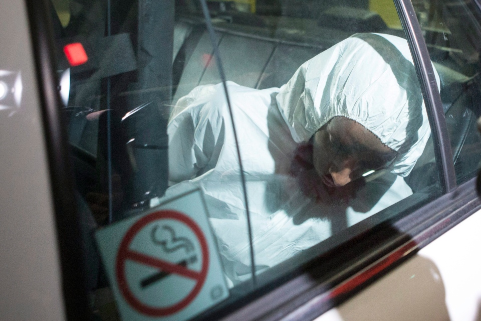 Ayanle Hassan Ali arrives in a police car at a Toronto court house on Tuesday, March 15, 2016. (The Canadian Press/Chris Young)
