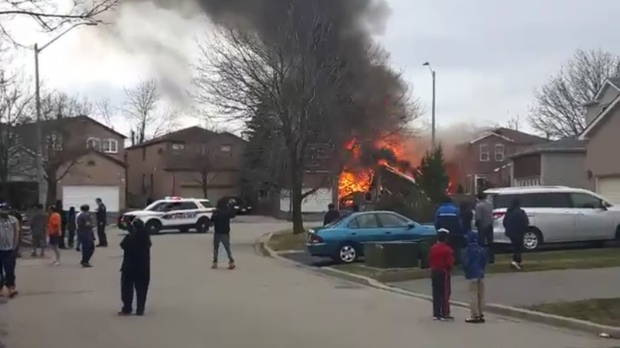 A home on Douglas Haig Drive is seen on fire on March 15, 2016. (Twitter/@Fabigeez)