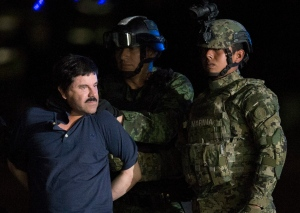 Mexican drug lord Joaquin 'El Chapo' Guzman is escorted by army soldiers to a waiting helicopter, at a federal hangar in Mexico City, on Jan. 8, 2016. (AP/Rebecca Blackwell)