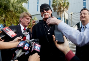 Hulk Hogan, whose given name is Terry Bollea, speaks to the media after a jury returned its decision Monday, March 21, 2016, in St. Petersburg, Fla. (Dirk Shadd/The Tampa Bay Times via AP)