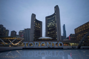 The neon sign outside Toronto's city hall stands unlit on Wednesday, March 23, 2016 in respect for former Toronto mayor Rob Ford, who died of cancer Tuesday, at the age of 46. THE CANADIAN PRESS/Chris Young
