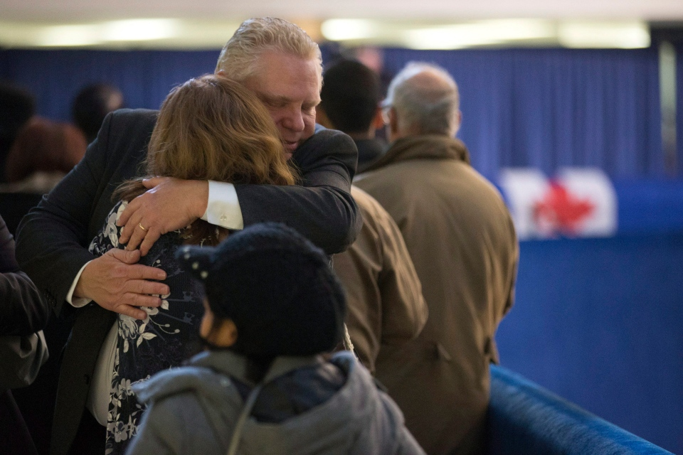 Doug Ford greets mourners as they line up to pay their respects to former mayor Rob Ford in Toronto's city hall on Monday, March 28, 2016. (The Canadian Press/Chris Young)