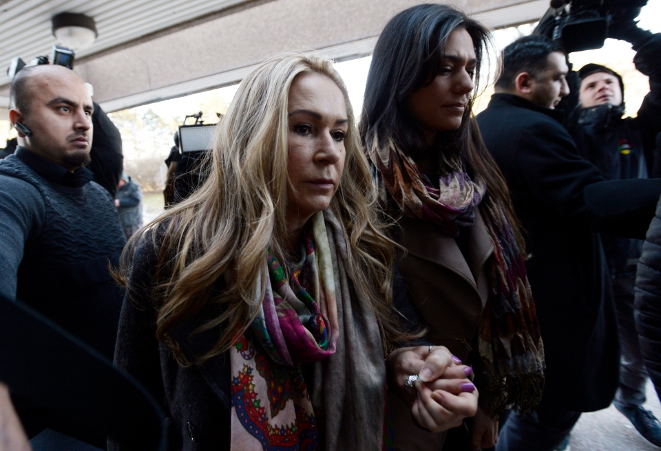 Dawn Muzzo, centre, mother of accused drunk driver Marco Muzzo, and his fiancee Taryn Hampton, centre right, arrive at court in Newmarket, Ont., on Tuesday, March 29, 2016. Marco Muzzo, who killed three children and their grandfather in a horrific crash north of Toronto, will be sentenced Tuesday.THE CANADIAN PRESS/Nathan Denette