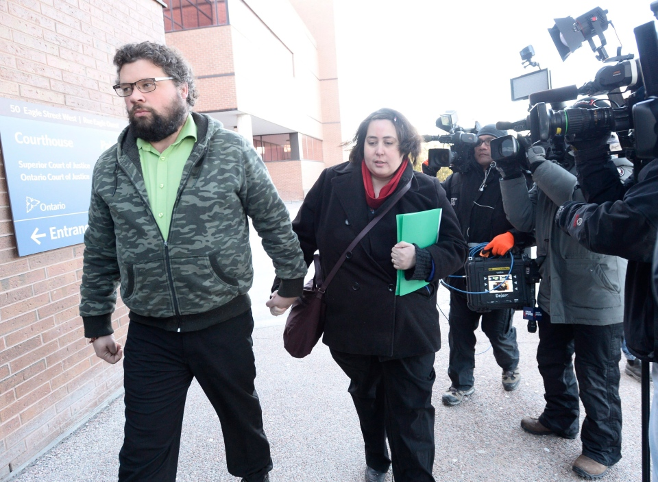 Jennifer Neville-Lake, centre, and her husband Edward Lake, who lost her three children and father in a horrific crash by drunk driver Marco Muzz, arrive at the court house in Newmarket, Ont., on Tuesday,, March 29, 2016. THE CANADIAN PRESS/Nathan Denette