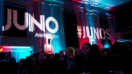 People watch as the 2015 Juno award nominations are presented during a press conference in Toronto on Tuesday, January 27, 2015. THE CANADIAN PRESS/Nathan Denette