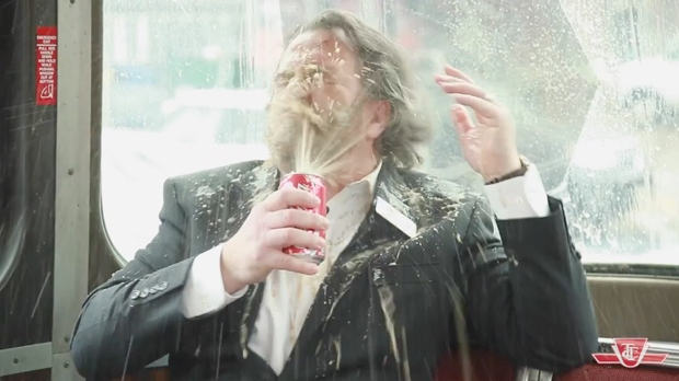 TTC spokesperson Brad Ross sprays himself with a can of pop in an April Fool's video. (TTC)