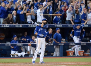 Toronto Blue Jays Jose Bautista flips his bat after hitting a three-run homer during seventh inning game 5 American League Division Series baseball action in Toronto on Oct. 14, 2015. (Chris Young / The Canadian Press)