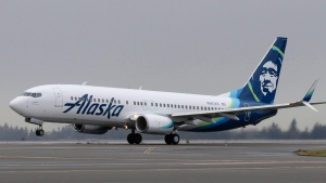 An Alaska Airlines Boeing 737-800 painted with the airline's new tail logo and livery takes off, Tuesday, Jan. 26, 2016, at Seattle-Tacoma International Airport in Seattle. (AP / Ted S. Warren)