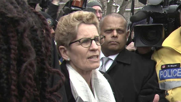 Premier Kathleen Wynne speaks with protesters at a Black Lives Matter protest at Queen's Park Monday April 4, 2016.