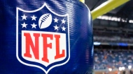 This Aug. 9, 2014 file photo shows an NFL logo on a goal post padding before a preseason NFL football game between the Detroit Lions and the Cleveland Browns at Ford Field in Detroit. (AP Photo/Rick Osentoski)