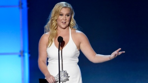 In this Jan. 17, 2016 file photo, Amy Schumer accepts the Critics' Choice MVP award at the 21st annual Critics' Choice Awards in Santa Monica, Calif. (Photo by Chris Pizzello / Invision / AP, File)