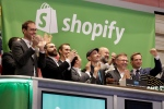 Shopify CEO Tobias Lutke, center wearing hat, is celebrated as he rings the New York Stock Exchange opening bell, marking the Canadian company's IPO, Thursday, May 21, 2015. (AP Photo/Richard Drew)