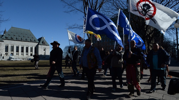 Metis Federation leaders and delagates march to the Supreme Court of Canada in Ottawa on Thursday, April 14, 2016. THE CANADIAN PRESS/Sean Kilpatrick