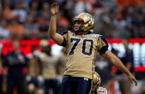Winnipeg Blue Bombers' Lirim Hajrullahu watches as his kick sails through the uprights for a field goal during the first half of a CFL football game against the B.C. Lions in Vancouver, B.C., on Friday, July 25, 2014. (The Canadian Press/Darryl Dyck)