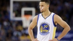 In this Friday, April 1, 2016 photo, Golden State Warriors' Steph Curry (30) pauses during an NBA basketball game against the Boston Celtics in Oakland, Calif. (AP Photo/Marcio Jose Sanchez)