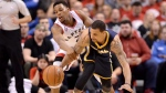 Toronto Raptors' Kyle Lowry (7) tries to block Indiana Pacers' George Hill (3) as he chases the ball during second half round one NBA basketball playoff action in Toronto on Saturday, April 16, 2016. THE CANADIAN PRESS/Frank Gunn