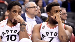 Toronto Raptors' Kyle Lowry, right, and DeMar DeRozan watch the game from the bench during second half NBA basketball action against the Oklahoma City Thunder in Toronto on Monday, March 28, 2016. THE CANADIAN PRESS/Frank Gunn
