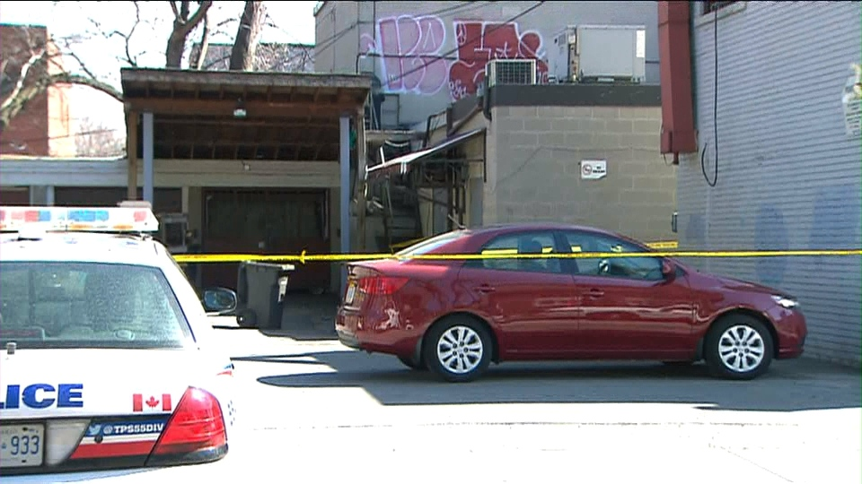 Police tape is seen behind a building in the Broadview Avenue and Gerrard Street East area following the discovery on what police said could be human remains on Tuesday, April 19, 2016.