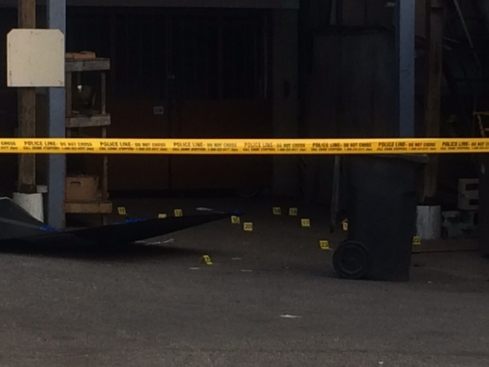 Police tape and evidence markers are seen following the discovery of what police believe are human remains in the Broadview Avenue and Gerrard Street East area on Tuesday, April 19, 2016. (CP24/Arda Zakarian)