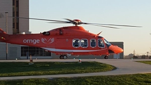 Ornge Air arrives at Victoria Hospital in London, Ont, with an 82-year-old man who was trapped under a tractor. (Justin Zadorsky / CTV London)