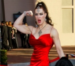FILE - In this Nov. 16, 2003 file photo, Joanie Laurer, former pro wrestler known as Chyna, flexes her bicep as she arrives at the 31st annual American Music Awards, in Los Angeles. Chyna, the WWE star who became one of the best known and most popular female professional wrestlers in history in the late 1990s, has died at age 45. Los Angeles County coroners Lt. Larry Dietz says Chyna, whose real name is Joan Marie Laurer, was found dead in Redondo Beach on Wednesday, April 20, 2016. (AP Photo/Kevork Djansezian, File)
