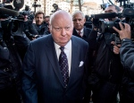 Suspended senator Mike Duffy is followed by his lawyer Donald Bayne (right) as he arrives at the courthouse in Ottawa, Ont. for his first court appearance on Tuesday, April 7, 2015. A verdict is expected Thursday in the trial of Duffy, who faces 31 charges related to his Senate expense claims. THE CANADIAN PRESS/Justin Tang