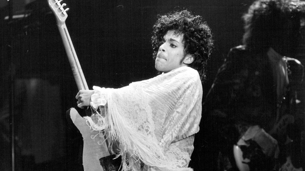 "In this Dec. 25, 1984 photo,  Prince performs at St. Paul Civic Center in St. Paul, Minn.  Prince, widely acclaimed as one of the most inventive and influential musicians of his era with hits including ""Little Red Corvette,"" ''Let's Go Crazy"" and ""When Doves Cry,"" was found dead at his home on Thursday, April 21, 2016 in suburban Minneapolis, according to his publicist. He was 57. (David Brewster/Star Tribune via AP)"