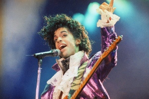 In this Feb. 18, 1985 file photo, Prince performs at the Forum in Inglewood, Calif. (AP Photo/Liu Heung Shing)
