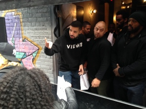 Drake hands out t-shirts to fans at a pop-up shop on Queen Street West Sunday April 24, 2016. (Kevin Hoppler /CP24)