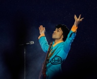 In this Feb. 4, 2007, file photo, Prince performs during the halftime show at Super Bowl XLI at Dolphin Stadium in Miami. (AP Photo/Alex Brandon)