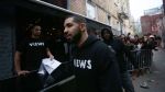 Toronto rapper Drake leaves a Queen St. West pop up shop where he was handing out T-shirts to promote his upcoming album in Toronto on Sunday, April 24, 2016. THE CANADIAN PRESS/Cole Burston