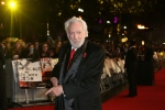 Donald Sutherland poses for photographers upon arrival at the premiere of the film 'The Hunger Games Mockingjay Part 2', in London, Thursday, Nov. 5, 2015. (Photo by Joel Ryan/Invision/AP)