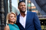 """In this Oct. 12, 2015 file photo, Kelly Ripa, left, poses with Michael Strahan, her co-host on the daily television talk show """"LIVE! with Kelly and Michael,"""" during a ceremony honoring Ripa with a star on the Hollywood Walk of Fame in Los Angeles. Ripa returns as co-host of the morning show after a four-day absence after ABC announced Tuesday that co-host Strahan will leave the show to join """"Good Morning America"""" full-time. (Photo by Chris Pizzello/Invision/AP, File)"""