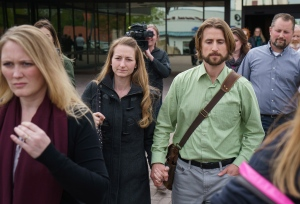 David and Collette Stephan leave the courthouse in Lethbridge, Alberta, April 26, 2016, surrounded by family and supporters after being found guilty in failing to provide the necessaries of life in the death of their 19-month-old Ezekiel 2012. The CANADIAN PRESS/David Rossiter