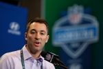 In this Feb. 25, 2016, file photo, San Diego Chargers general manager Tom Telesco speaks during a news conference at the NFL football scouting combine in Indianapolis. With the Rams and Eagles having traded up to secure the top two spots, where they have said they will take quarterbacks, it's San Diego that likely will determine the flow on Thursday night. Telesco has not been shy about making draft-day deals. (AP Photo/Michael Conroy, File)