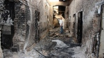 In this Oct. 16, 2015, file photo, an employee of Doctors Without Borders stands inside the charred remains of their hospital after it was hit by a U.S. airstrike in Kunduz, Afghanistan. The U.S. military is acknowledging that its airstrikes killed 20 civilians in Iraq and Syria over a five-month period that began last September. Central Command announced the results of multiple investigations of claims of civilian deaths from airstrikes aimed at Islamic State targets between Sept. 10, 2015 and Feb. 2, 2016. Six of the strikes were in Iraq and three were in Syria. (Najim Rahim via AP, File)