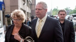 Rob Ford's mother Diane Ford (left) walks back to Mount Sinai Hospital with family members Doug Ford and Michael Ford (right) after speaking to the media in Toronto on Monday, May 11, 2015. THE CANADIAN PRESS/Chris Young