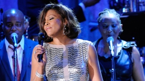 In this Feb. 13, 2011 file photo, singer Whitney Houston performs at the pre-Grammy gala & salute to industry icons with Clive Davis honoring David Geffen in Beverly Hills, Calif. Pat Houston, the late singer's sister-in-law and head of her estate, says she's had offers to debut a Whitney Houston hologram, but she won't sign on just yet. Whitney Houston died in 2012 at age 48. Acts from Michael Jackson to Tupac Shakur have been presented in hologram form. (AP Photo/Mark J. Terrill, File)