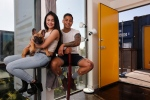 "In this Wednesday, March 16, 2016, photo, Patrick Tupas, right, with his wife, Maria Real-Tupas, who is holding their dog Moon Moon Fitzgerald, sit in the living room at their shipping container apartment in Phoenix. ""It doesn't even feel like a shipping container. It's also insulated really well,"" said Patrick Tupas, who is in the Air Force. ""It just feels like a regular apartment."" (AP Photo/Ross D. Franklin)"