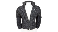 """This image released by Profiles in History shows a black and white blazer with leather sleeves, worn by Prince in the 1984 film, """"Purple Rain."""" (Charlie Nunn/Profiles in History via AP)"""