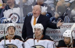 In this April 22, 2015 file photo, Anaheim Ducks coach Bruce Boudreau disputes a call during the third period of Game 4 of a first-round NHL hockey playoff series, in Winnipeg, Manitoba. The Anaheim Ducks have fired coach Bruce Boudreau after their first-round exit from the playoffs. Ducks general manager Bob Murray announced the decision Friday, April 29, 2016.. (John Woods/The Canadian Press via AP, File)