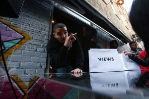 Toronto rapper Drake poses for photos as he hands out T-shirts at a pop up shop on Queen St. West to promote his new album in Toronto on Sunday, April 24, 2016. THE CANADIAN PRESS/Cole Burston