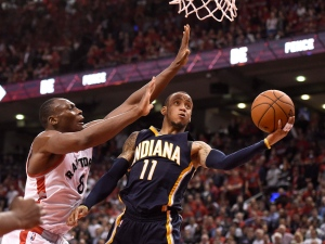 Toronto Raptors' Bismack Biyombo defends as Indiana Pacers' Monta Ellis (11) drives to the basket during second half NBA playoff basketball action against the Indiana Pacers in Toronto on Tuesday, April 26, 2016. THE CANADIAN PRESS/Frank Gunn