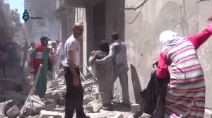 This image made from video released by Qasion News Agency, a media opposition platform that relies on a network of activists on the ground, on Friday, April 29, 2016 shows people scrambling through rubble following airstrikes in Aleppo, Syria. (Qasion News Agency via AP)