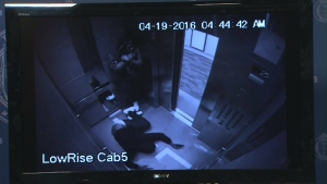 Two males are seen brandishing firearms inside an elevator at 300 Front Street on April 19 in a surveillance camera image.
