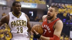 Toronto Raptors' Jonas Valanciunas (17) goes to the basket against Indiana Pacers' Ian Mahinmi (28) during the first half of Game 6 of an NBA first-round playoff basketball series Friday, April 29, 2016, in Indianapolis. (AP Photo/Darron Cummings)