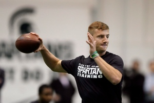 Quarterback Connor Cook throws during a drill for NFL scouts at a Pro Day college football workout at Michigan State University, Wednesday, March 16, 2016, in East Lansing, Mich. (AP Photo/Carlos Osorio)