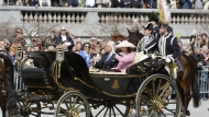 Sweden's Queen Silvia and King Carl XVI Gustaf leave the Royal Palace in an open carriage for the lunch hosted by the City of Stockholm at the City Hall, during celebrations for the king's 70th birthday, in Stockholm,  Saturday, April 30, 2016. (Jessica Gow/TT News Agency via AP)  SWEDEN OUT