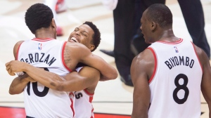 Toronto Raptors guard Kyle Lowry (7) celebrates with Toronto guard DeMar DeRozan (10) and Raptors centre Bismack Biyombo (8) after defeating the Indiana Pacers during second half round one NBA basketball playoff action in Toronto on Tuesday, April 26, 2016. THE CANADIAN PRESS/Nathan Denette